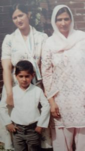 A young Kal Sabir with his sister and mother.