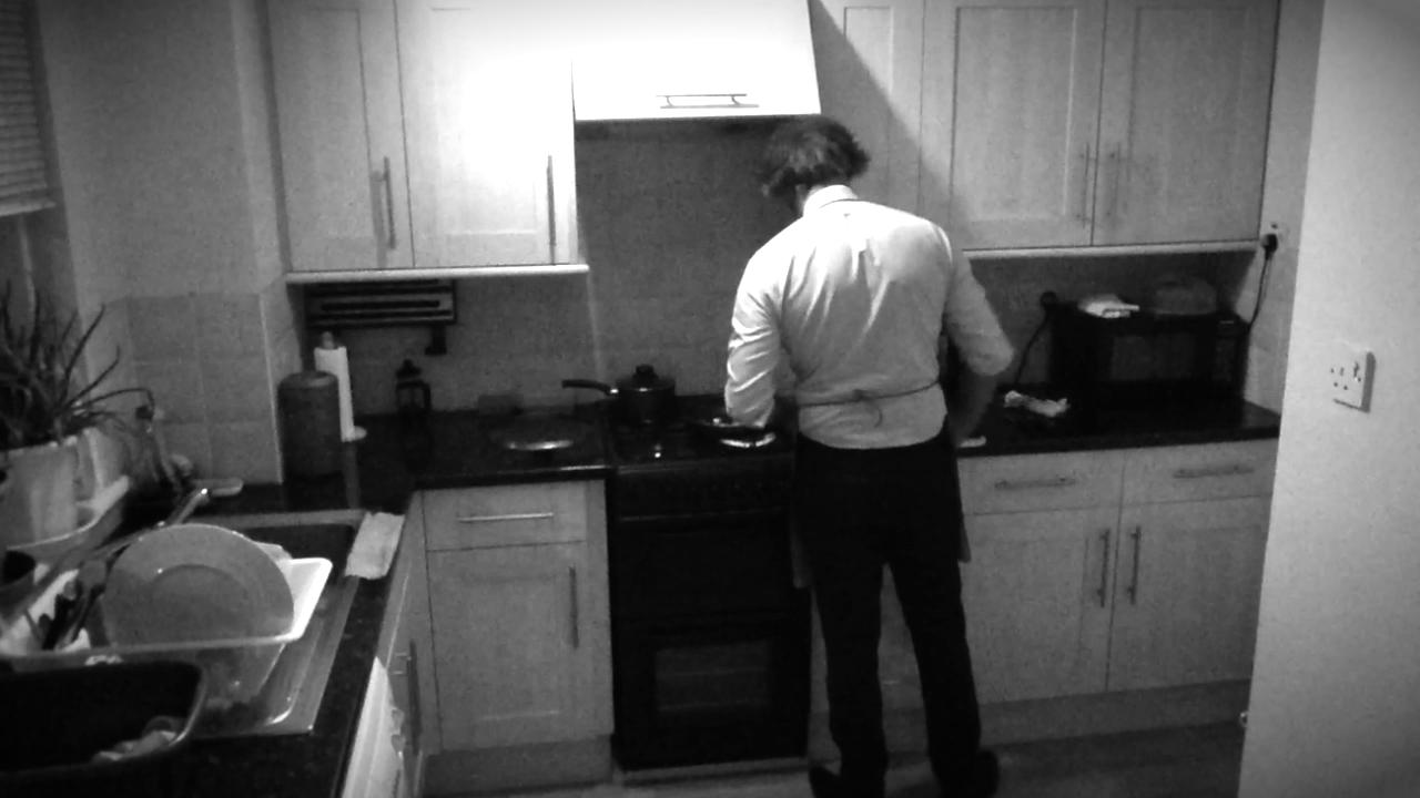 Kal Sabir cooking in the kitchen in short film Eat Me.