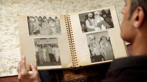 Raj in Jasmine with family album.